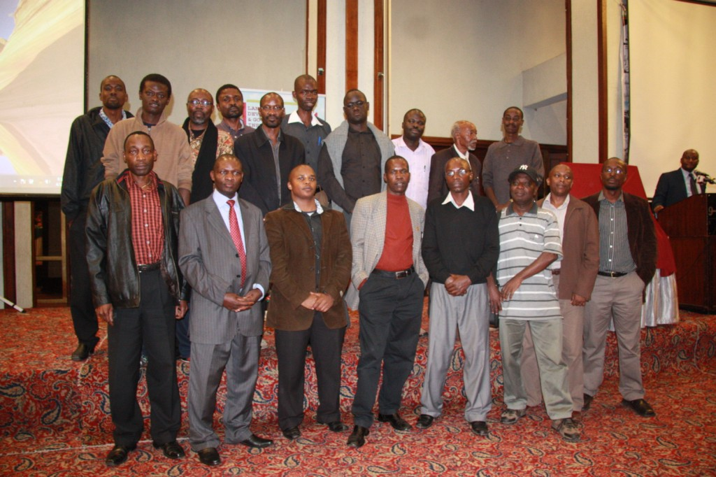 LDGI Chairman Mr. Ibrahim Mwathane poses with a section of the cartoonists in attendance at the event